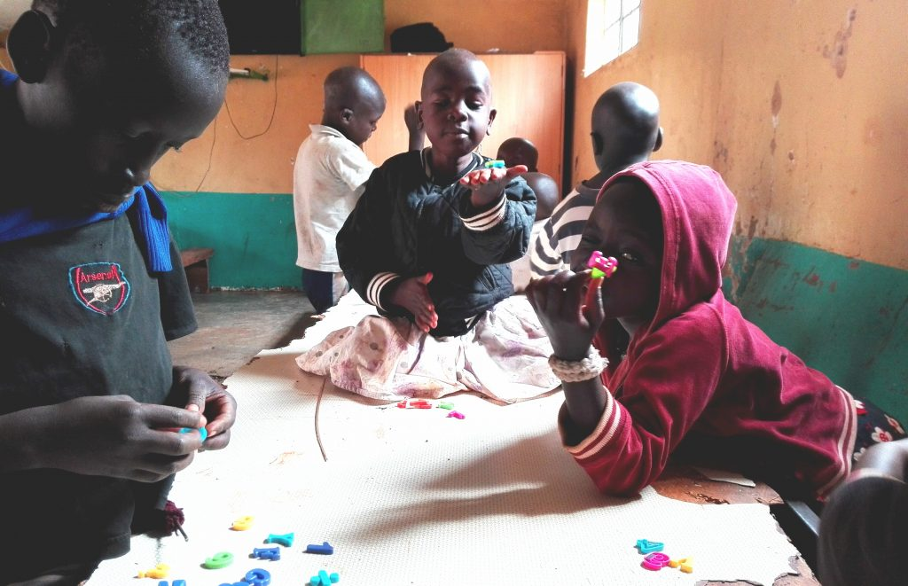 kids playing with abcs