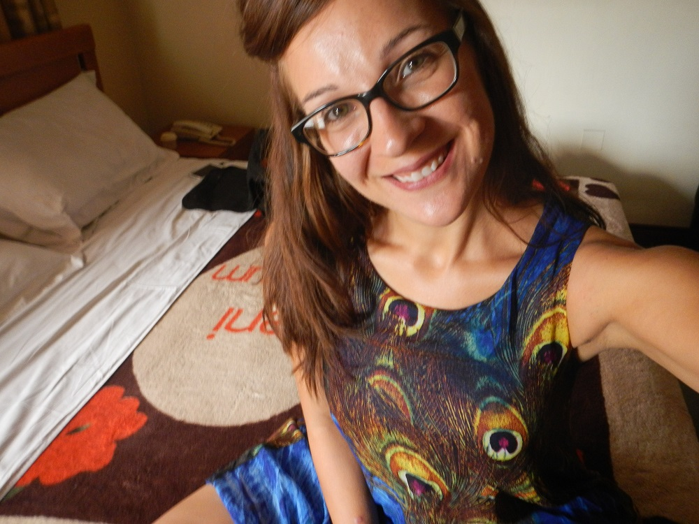 Me in my new peacock dress in my hotel room. Yay!